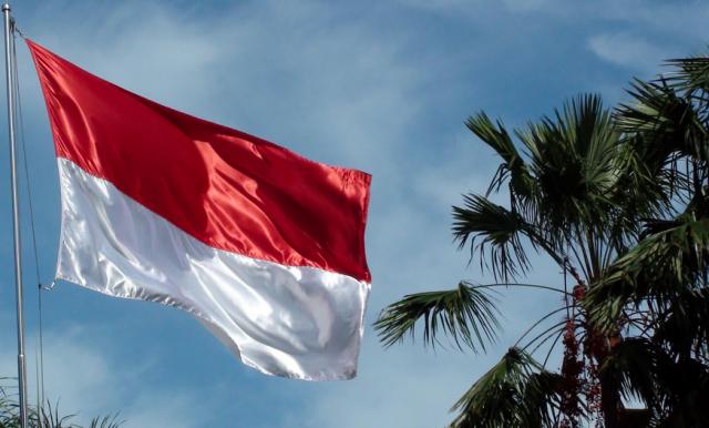 Republic Of Indonesia Flag Waving In Jakarta Java - Photo Credit: LIVINUS