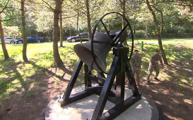 Bell is rung to announce one minute of slience - The Indisch Monument area, The Hague
